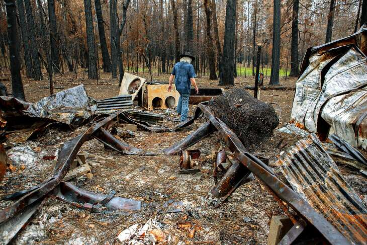 Art Castile at the charred remains of his home on Tuesday, March 5, 2019, in Concow, Calif. The neighborhood was devastated by the Camp Fire last November.