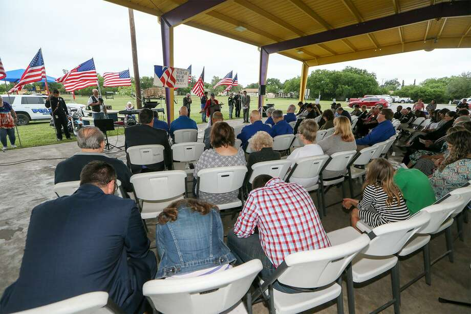 People pray during the National Day of Prayer observance at Converse City Park on Thursday. Photo: Marvin Pfeiffer /Staff Photographer / Express-News 2019