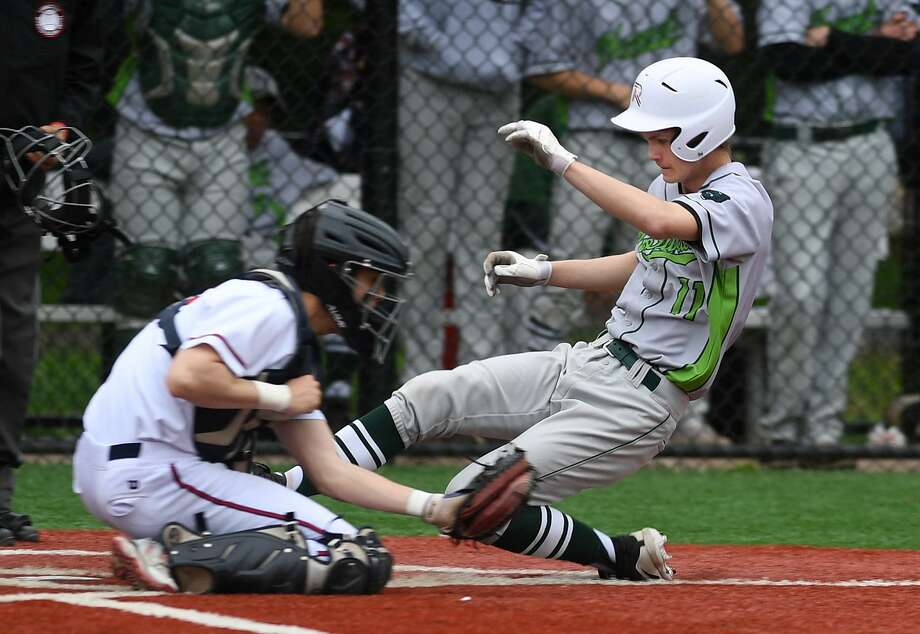 Norwalk's Brendan Edvardsen scores ahead of the tag of Brien McMahon catcher Chris Clemens in the 5th inning of their FCIAC baseball game at Brien McMahon High School in Norwalk, Conn. on Monday, May 6, 2019. Photo: Brian A. Pounds / Hearst Connecticut Media / Connecticut Post