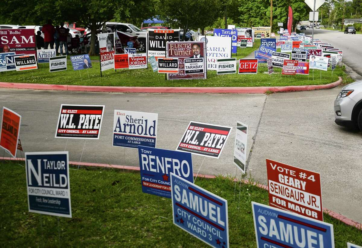Signs line the road outside of Judge John Paul Davis Community Center Tuesday as people vote early in the area's elections. Photo taken on Tuesday, 04/3019. Ryan Welch/The Enterprise
