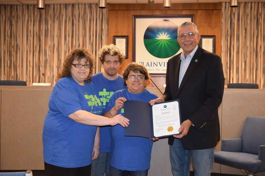 Donna Vernon, Chance Autry and Tami Vernon stand with