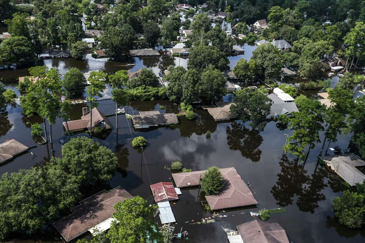 Homes are submerged by floodwaters of Tropical Storm Harvey on Friday, Sept. 1, 2017, Vidor, Texas. ( Brett Coomer / Houston Chronicle )