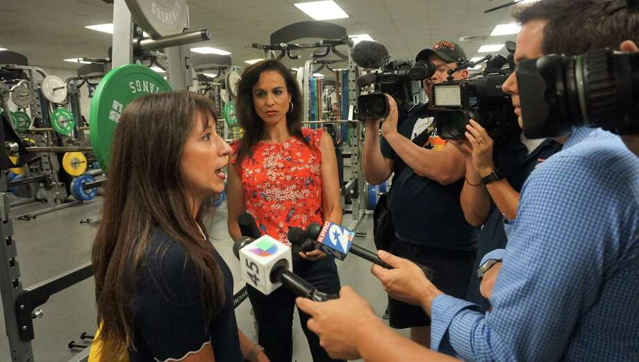 Humble ISD Superintendent Elizabeth Fagen answers questions from local media in the weight room of Kingwood High School, which had a couple of inches of water inside, on May 6 in Kingwood. Photo: Nguyen Le / Staff Photo