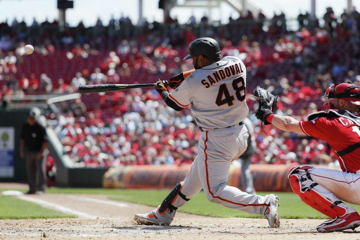 San Francisco Giants' Pablo Sandoval hits a three-run home run off Cincinnati Reds starting pitcher Anthony DeSclafani in the sixth inning of a baseball game, Monday, May 6, 2019, in Cincinnati. (AP Photo/John Minchillo)