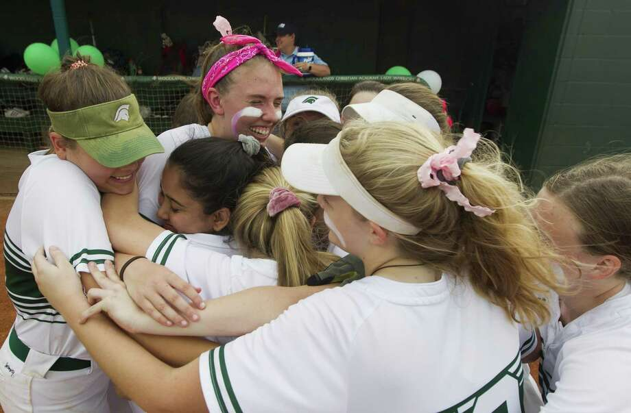 In this file photo, The Woodlands Christian Academy starting pitcher Faith Hanshaw, pink headband, gets group hug from teammates before her final home softball game, Tuesday, April 30, 2019, in The Woodlands. Photo: Jason Fochtman, Houston Chronicle / Staff Photographer / © 2019 Houston Chronicle