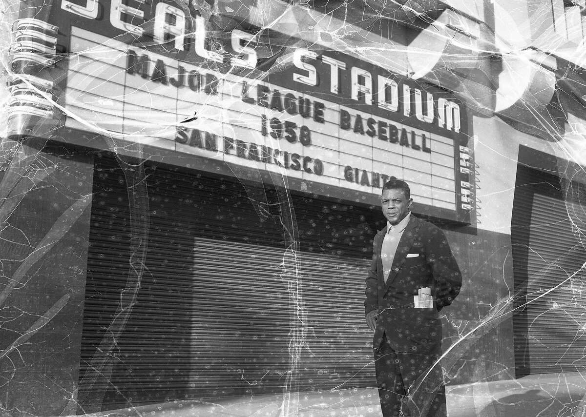 Willie Mays poses in front of Seals Stadium during an October 31, 1957 photo shoot, the year before the outfielder made his debut as a San Francisco Giant.