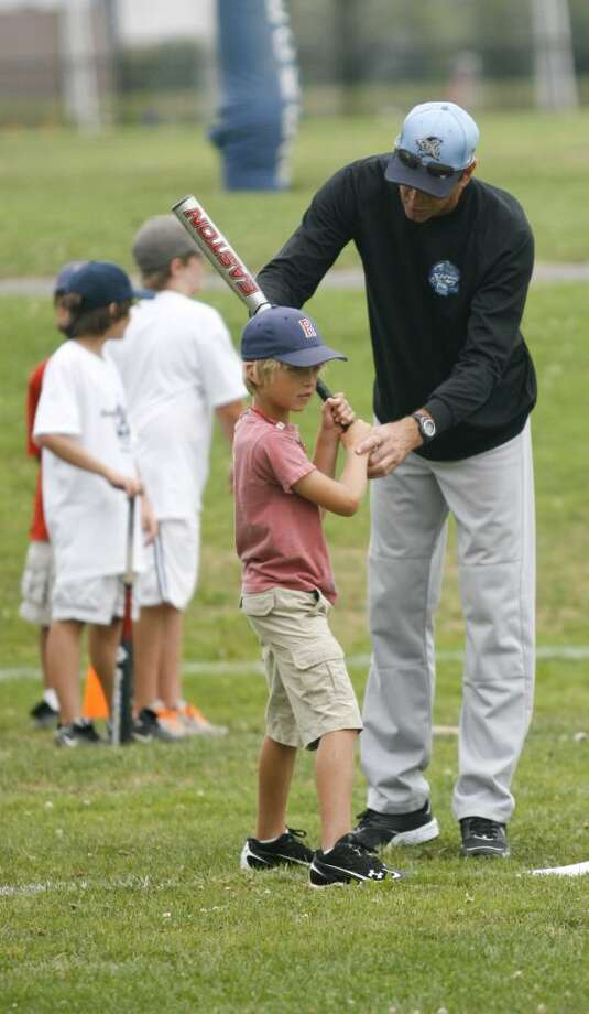 Retired professional baseball player, Von Hayes, gives batting tips to Max Chermayeff, age 9, at Westport's Baseball World camp at Wakeman Field on Friday, July 23, 2010. Photo: Laura Buckman / Connecticut Post
