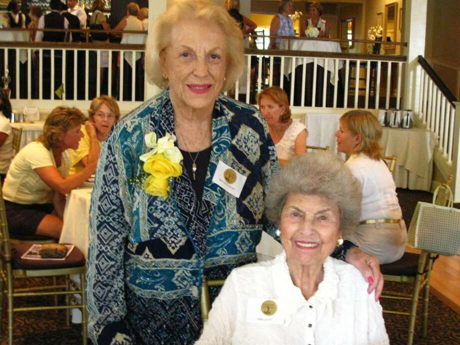 From left, Longshore Women's Golf Association (LWGA) founders Beryl Buck-Miller and Mimi Levitt celebrate the LWGA's 50th anniversary at the Inn at Longshore on July 20. Photo: Contributed Photo / Jeanne Klinge
