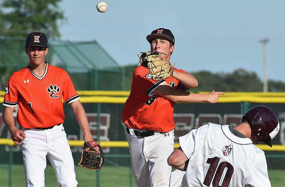 Edwardsville second baseman Logan Cromer fires to first to complete a 6-4-3 double play against Belleville West in Belleville. Photo: Matt Kamp/The Intelligencer