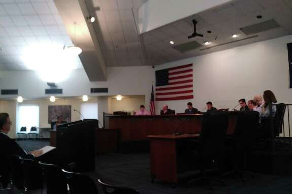 Candidate for city council Simon Hughes sits before the current Jersey Village City council.