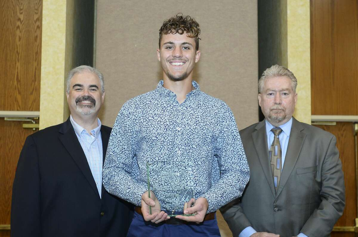 Baseball player Dilyn Bishop, from Kirbyville, stands with their award with Beaumont Enterprise Chief Revenue Officer Craig Hatcher and sponsor Ken Murray of Mid County Chrysler Dodge Jeep Ram and Fiat during the spring Super Gold award ceremony, honoring star athletes at the MCM Elegante Hotel Monday night. Photo taken on Monday, 05/06/19. Ryan Welch/The Enterprise