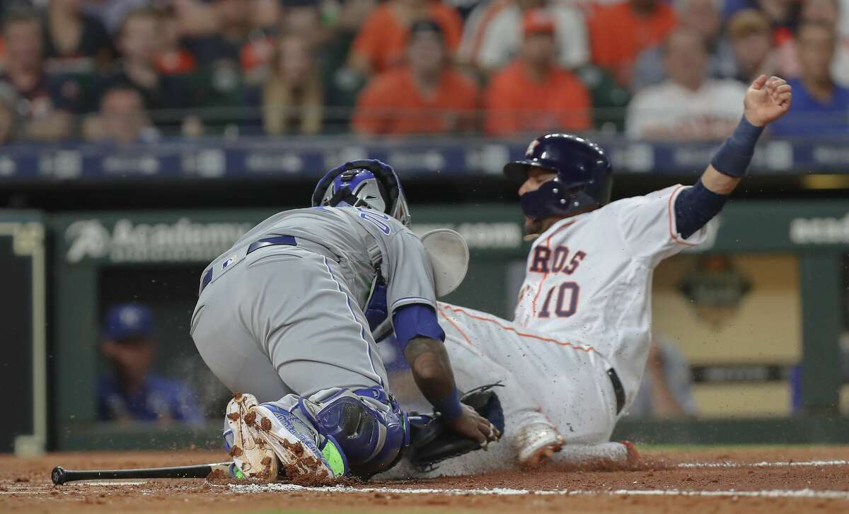 Houston Astros first baseman Yuli Gurriel (10) is tagged out at home by Kansas City Royals catcher Martin Maldonado (16) during the 2nd inning of an MLB baseball game at Minute Maid Park Monday, May 6, 2019, in Houston.
