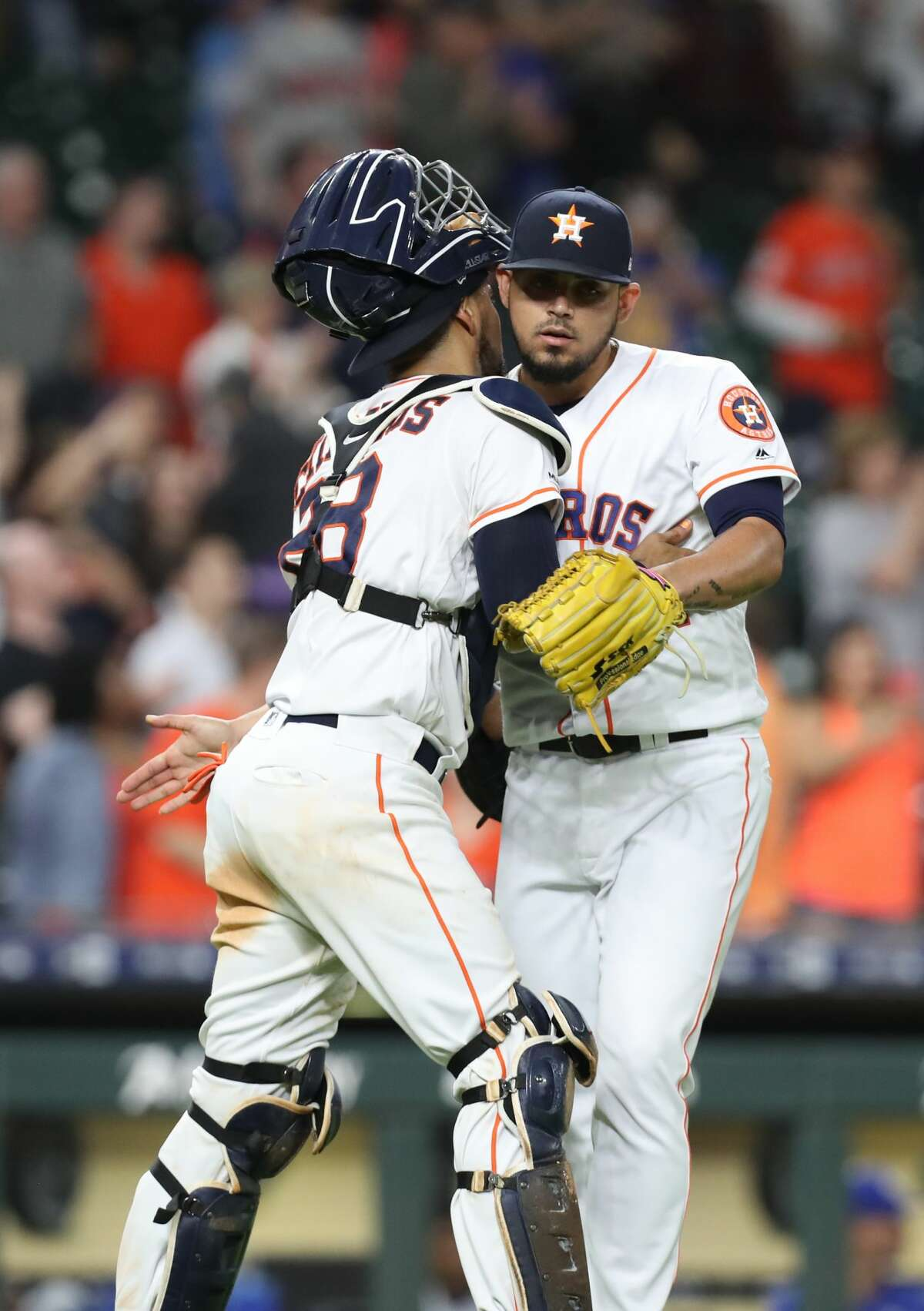 Houston Astros catcher Robinson Chirinos (28) congratulates Houston Astros relief pitcher Roberto Osuna (54) after defeating the Kansas City Royals in a MLB baseball game at Minute Maid Park Monday, May 6, 2019, in Houston.