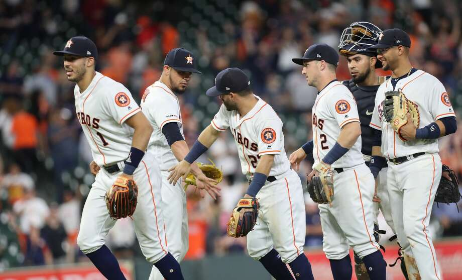 Houston Astros players congratulates Houston Astros relief pitcher Roberto Osuna (54) after defeating the Kansas City Royals in a MLB baseball game at Minute Maid Park Monday, May 6, 2019, in Houston. Photo: Steve Gonzales/Staff Photographer
