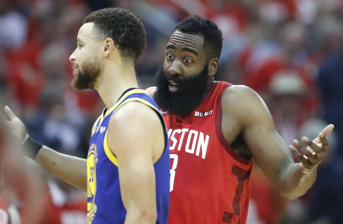 Houston Rockets guard James Harden (13) argues a call as he stands next to Golden State Warriors guard Stephen Curry (30) during the first half of Game 4 of a NBA Western Conference semifinal playoff game at Toyota Center, in Houston , Monday, May 6, 2019.