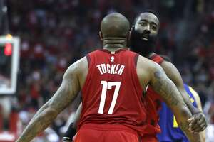 Houston Rockets forward PJ Tucker (17) and guard James Harden (13) celebrate a play against the Golden State Warriors during the first half of Game 4 of a NBA Western Conference semifinal playoff game at Toyota Center, in Houston , Monday, May 6, 2019.