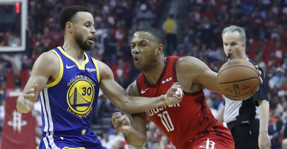 PHOTOS: Rockets vs. Grizzlies Houston Rockets guard Eric Gordon (10) works against Golden State Warriors guard Stephen Curry (30) during the first half of Game 4 of a NBA Western Conference semifinal playoff game at Toyota Center, in Houston , Monday, May 6, 2019. >>>See more photos from the Rockets' last game ... Photo: Karen Warren/Hearst Newspapers