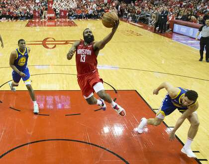 eda26d011fe8 Rockets guard James Harden (13) drives to the basket for a layup past Golden  State Warriors center Kevon Looney (left) and guard Klay Thompson during  the ...