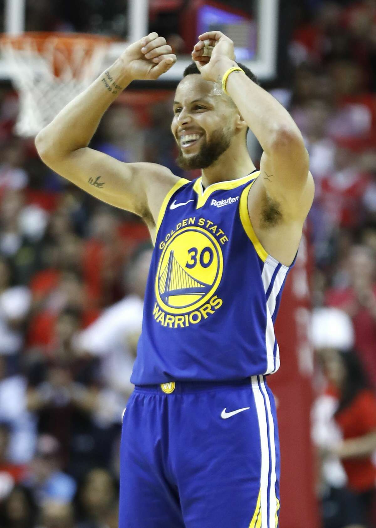 Golden State Warriors guard Stephen Curry (30) reacts to a fould call during the second half of Game 4 of a NBA Western Conference semifinal playoff game against the Houston Rockets at Toyota Center, in Houston , Monday, May 6, 2019.