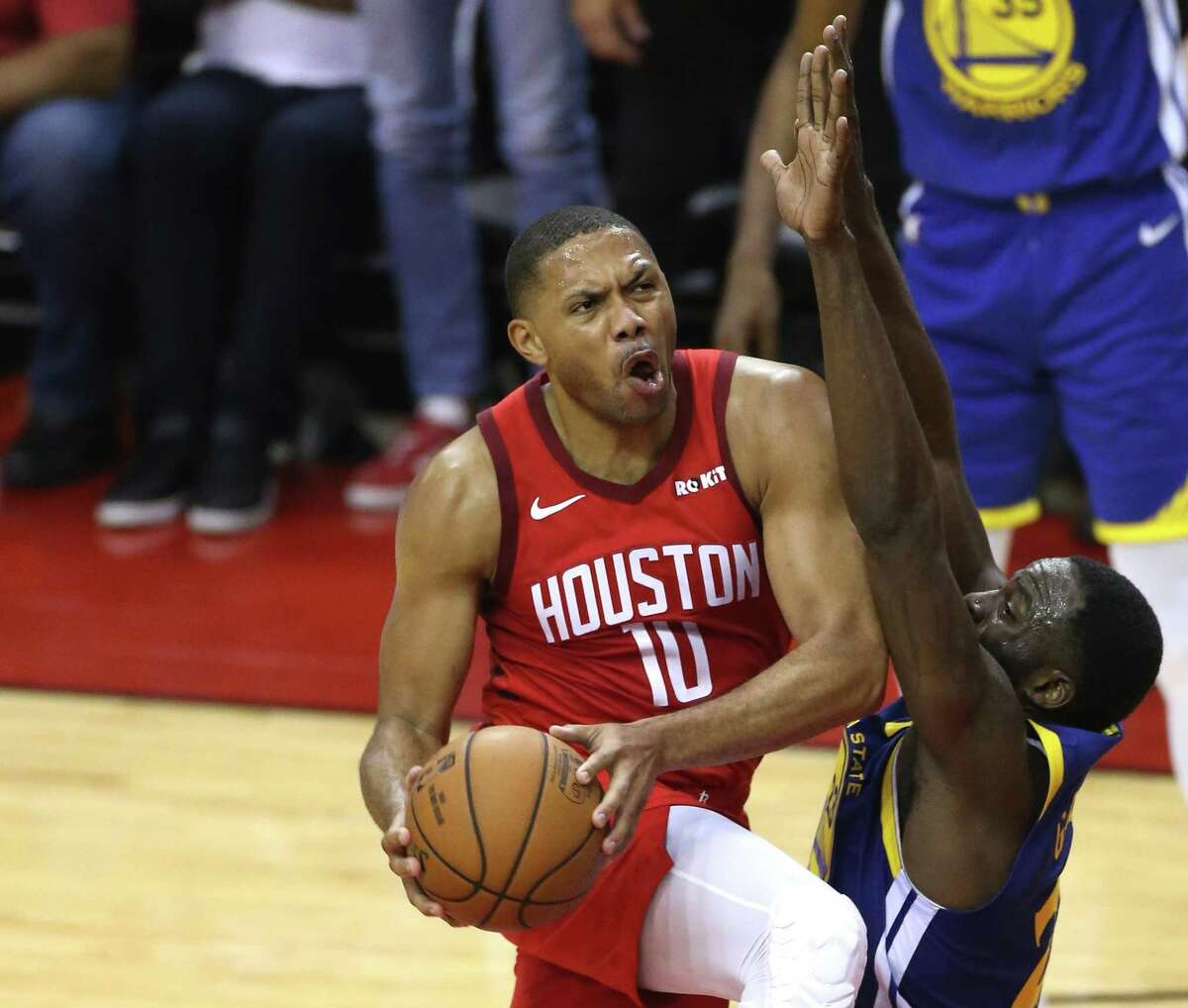 Rockets guard Eric Gordon (10) drives to the basket against Golden State Warriors forward Draymond Green (23) during the second half