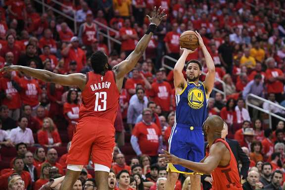 Golden State Warriors guard Klay Thompson (11) shoots over Houston Rockets guard James Harden (13) during the second half in game 4 of the NBA Western Conference Semifinals between the Golden State Warriors and Houston Rockets at the Toyota Center in Houston, Texas, on Monday, May 6, 2019.