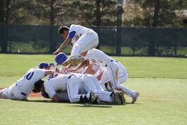 Hale Center Owls celebrate after a series win over Post on Saturday keeping them in for another round of playoffs.