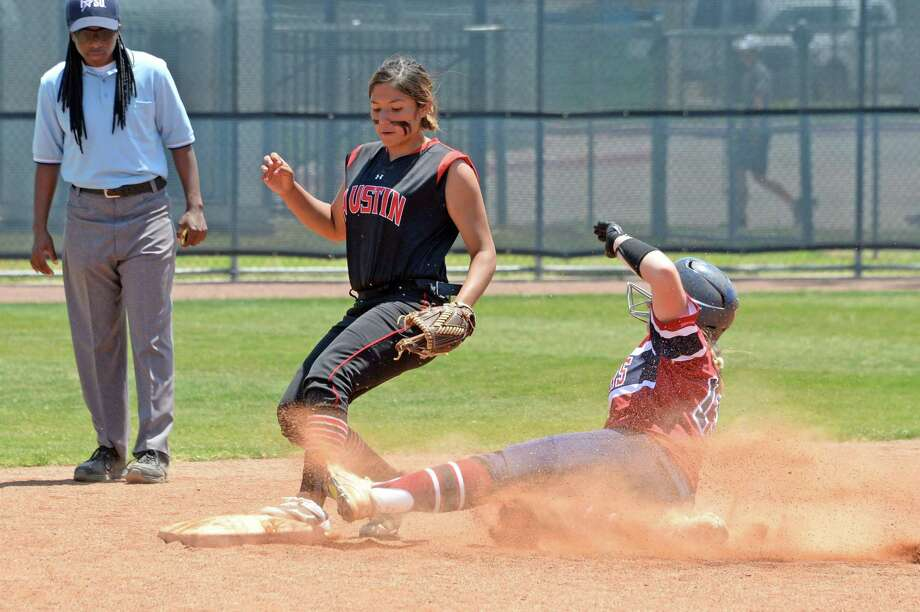 Natalya Cuevas (6) of Austin makes a force out at second base against Mackenzie Brown (13) of Tompkins in the third inning of a bi-district playoff game between the Tompkins Falcons and the Ft Bend Austin Bulldogs on April 28, 2018 at Tompkins HS, Katy, TX. Photo: Craig Moseley, Staff / Houston Chronicle / ©2018 Houston Chronicle