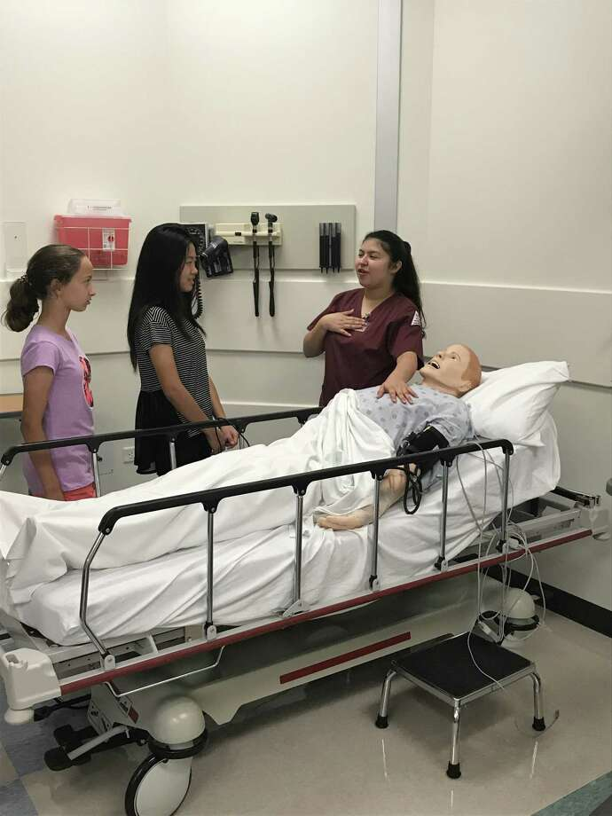 Campers learn how to work with a patient simulator as a part of The Health Museum's summer Discovery Camps. Photo: The Health Museum