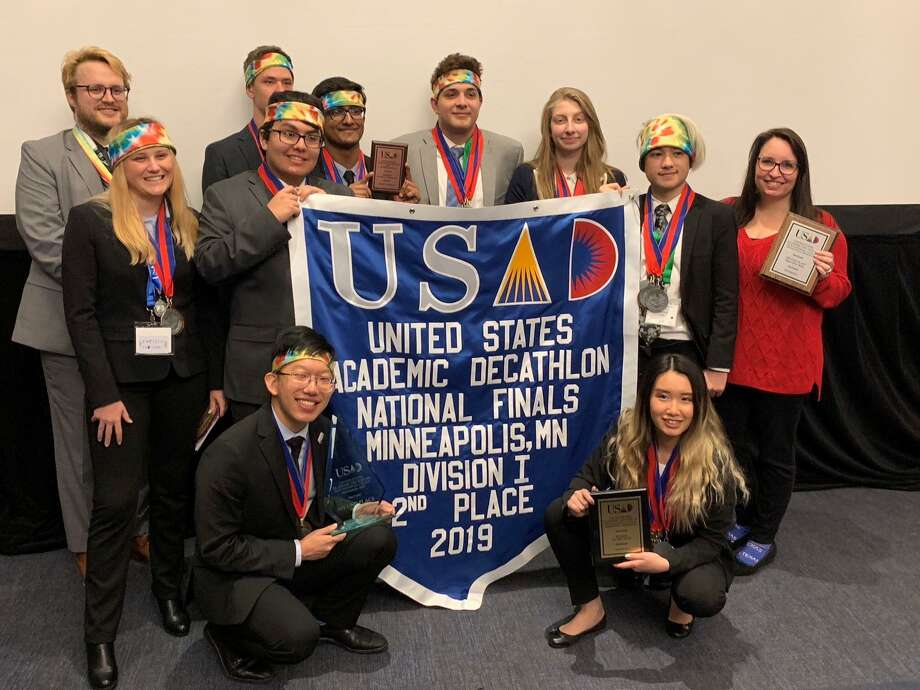 Dulles High School's Academic Decathlon team placed second among Division I schools at the 2019 U.S. Academic Decathlon national competition April 25-27. It also was awarded the Rookie of the Year Award and won third place overall. From left, front row, are: Robert Yang and Sophie Yangyi; middle row: Olivia Jackson, Simon Sanchez-Paiva, Davis Varghese, Ali Abi Nassif, Lana Haffar, Logan House and Kelsey Halfen; back row: Andrew Hartman and Ethan Sollenberger. Photo: Dulles High School Academic Decathlon Team / Dulles High School Academic Decathlon Team