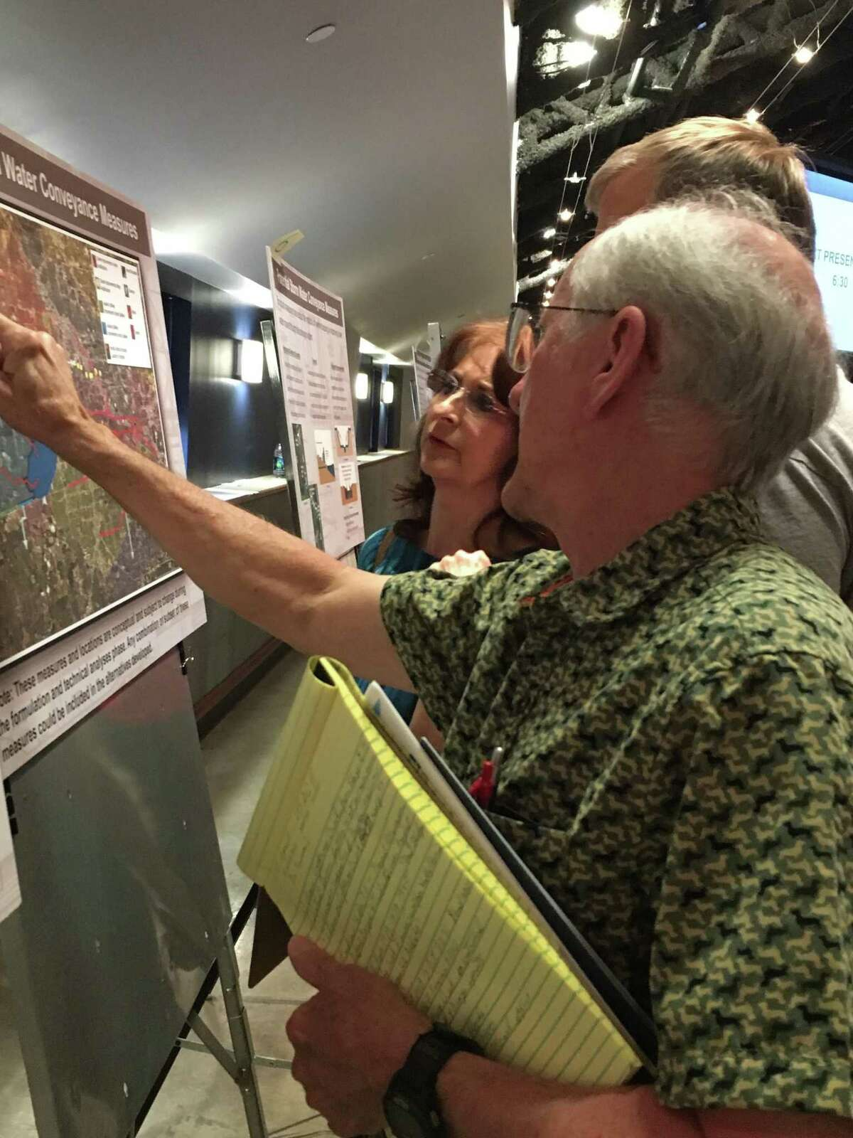 Charts, maps and other graphics lined the meeting room at Kingsland Baptist Church where residents could talk with representatives of the U.S. Army Corps of Engineers about its study to mitigate flooding along Buffalo Bayou and its tributaries.