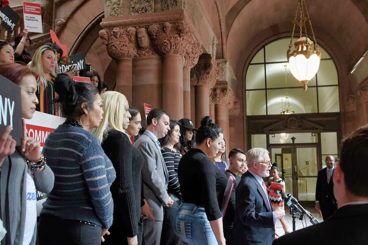Assemblymember Richard Gottfried, right, addresses those gathered for a rally at the Capitol on Tuesday, May 7, 2019, in Albany, N.Y. Sex workers, trafficking survivors, and advocates from Decrim NY held a rally with legislators to push for passage of legislation that would decriminalize prostitution in New York (Paul Buckowski/Times Union)