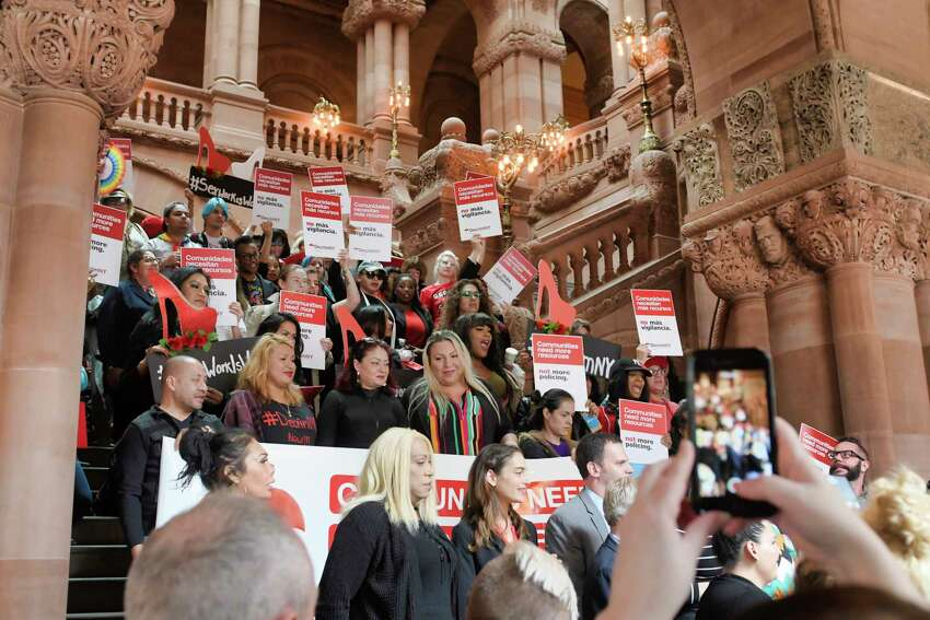 Sex workers, trafficking survivors, and advocates from Decrim NY take part in a rally with legislators to push for passage of legislation that would decriminalize prostitution in New York on Tuesday, May 7, 2019, in Albany, N.Y. (Paul Buckowski/Times Union)