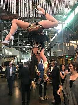 Trapeze artist near entrance to Exploratorium party