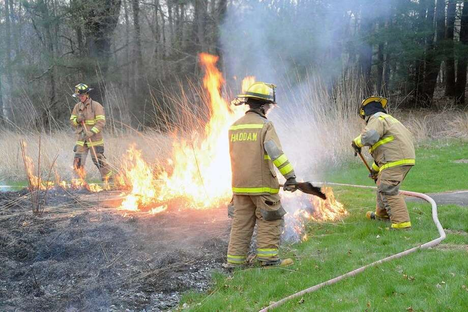 Haddam Volunteer Fire Co.'s Junior Division recently helped with a controlled burn at the Middlesex County Extension Center on Saybrook Road. Photo: Olivia Drake Photo