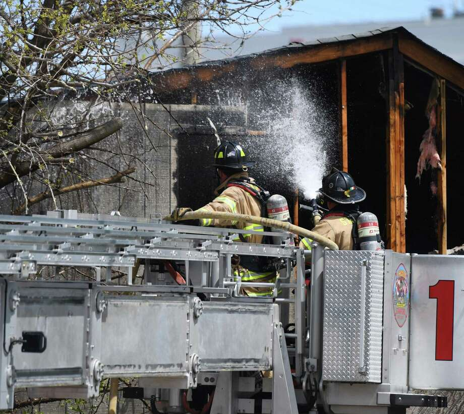 Stamford firefighters respond to a fire at 37 Manhattan St. in Stamford, Conn. Monday, April 29, 2019. The abandoned garage fire was extinguished promptly but caused traffic woes near the train station. Photo: Tyler Sizemore / Hearst Connecticut Media / Greenwich Time