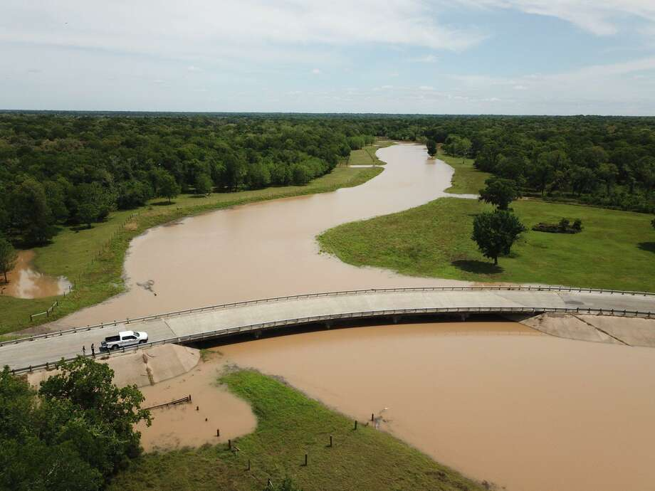 The Fort Bend County Office of Emergency Management flew the area of Cow Creek at Cow Creek Road on Monday, May 6, 2019, morning. The bridge is still passable but water levels are rising. That area of the county is under a flood warning. Officials warn that as the river continues to rise, eventually this bridge will become impassable. Photo: Fort Bend County Office Of Emergency Management