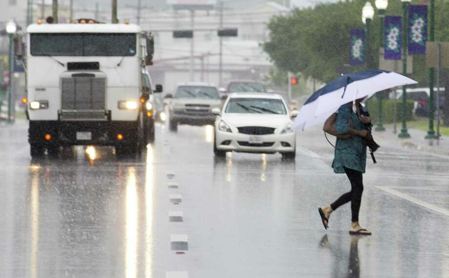 A woman walks with an umbrella through the rain as thunderstorms pass through the Conroe area, Tuesday, May 7, 2019, in Conroe. Photo: Jason Fochtman, Houston Chronicle / Staff Photographer / © 2019 Houston Chronicle