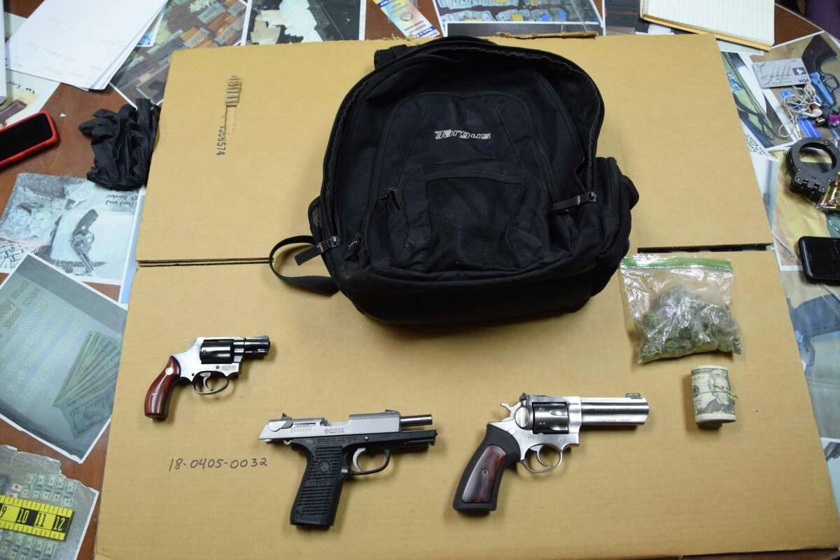 Two revolvers and a semiautomatic pistol captured during a police chase onto Julia A Start elementary school grounds in Glenbrook on Thursday April 5, 2018.