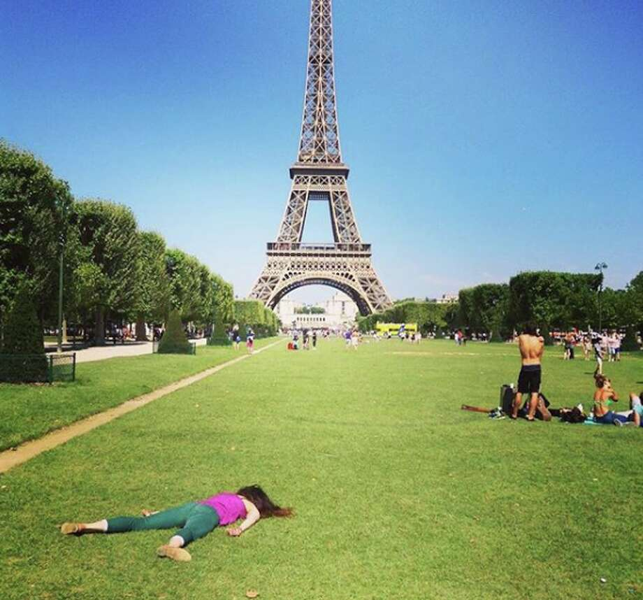 "Stephanie Leigh visits the Eiffel Tower in Paris in her own macabre way. The artist's ""Stef Dies"" project on Instagram, which shows her playing dead at famous sites, mocks selfie culture. (Photo courtesy of Stephanie Leigh) Photo: Stephanie Leigh/Instagram"