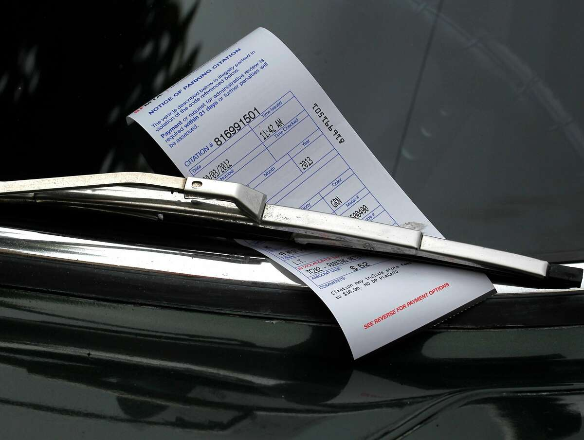 A $62 parking ticket is left for the driver of a car parked at an expired meter on West Portal Avenue in San Francisco, Calif. on Monday, Sept. 3, 2012. Officers were issuing parking violations city-wide during the Labor Day holiday.