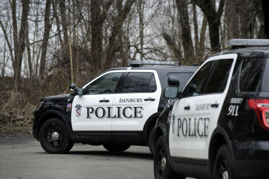 Police appear to have at least three suspects in custody after a car jacking at around 10 a.m. Friday, April 7, 2017.  in the Great Plains area of the city near the Danbury Town Park that forced two local schools into lockdown. The suspects drove to the end of Hawley Road Ext and fled on foot into the nearby woods. Police took the suspects into custody after a foot chase. Photo: Carol Kaliff / Hearst Connecticut Media / The News-Times