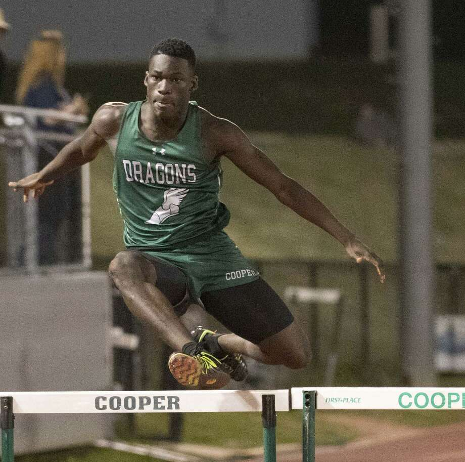 Tega Ewherido won the SPC championship in the 300-meter hurdles. Photo: Lynn Boeding