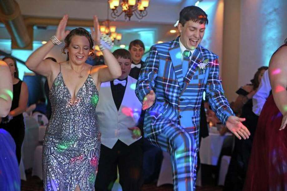 North Huron students Ashley Koglin and Nick Craig tear up the dance floor at prom Saturday night. North Huron prom was held at the Pasta House in Kinde. For more photos from the night, see Page 8A. (Mike Gallagher/Huron Daily Tribune)