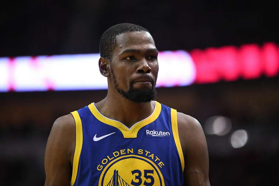 Kevin Durant is seen between plays during the second half in game 4 of the NBA Western Conference Semifinals. Is he friends with Chris Broussard? Do they DM each other? We may never know. Photo: Loren Elliott / Special To The Chronicle