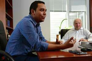 Norwalk Nagarote Sister City Project (NNSCP) Field Director Miguel Salinas talks with NNSCP Executive Director John Woyke at Brody and Associates in Westport, Conn. Salinas has been in Norwalk this past week talking to the NNSCP board members and stake holders about creating a preschool in Norwalk's Nicaraguan sister city Nagarote.