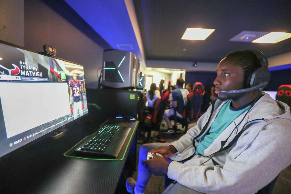 University of Downtown-Houston freshman Franklin Daniels practice his Madden '19 skills Wednesday, May 1, 2019, in Houston. UHD opened the city's first college esports center in November, a space where gamers can connect and bond, and for the official UHD eSports Team to compete against other universities.
