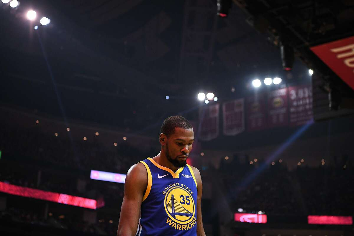 Golden State Warriors forward Kevin Durant (35) is walks away from the basket following a play during the first half in game 4 of the NBA Western Conference Semifinals between the Golden State Warriors and Houston Rockets at the Toyota Center in Houston, Texas, on Monday, May 6, 2019.
