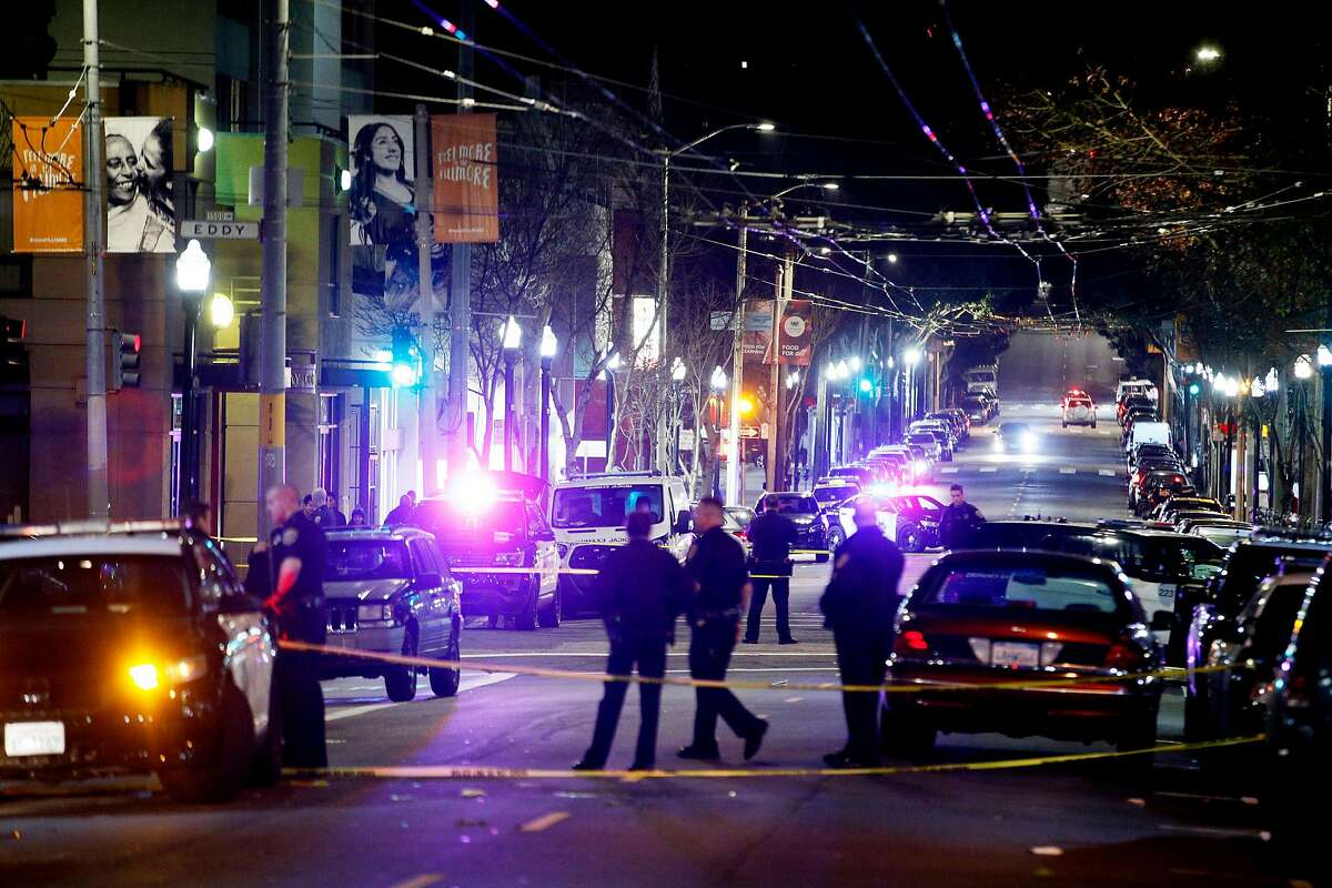 Police investigate a shooting along Fillmore Street on Saturday, March 23, 2019, in San Francisco, Calif. Police said that one person is dead and another three injured in the shooting.