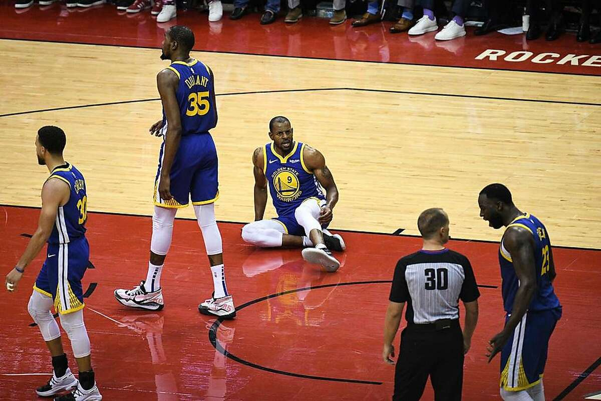 Golden State Warriors guard Andre Iguodala (9) and forward Draymond Green (23) show their frustration with an official during the second half in game 3 of the NBA Western Conference Semifinals between the Golden State Warriors and Houston Rockets at the Toyota Center in Houston, Texas, on Saturday, May 4, 2019.