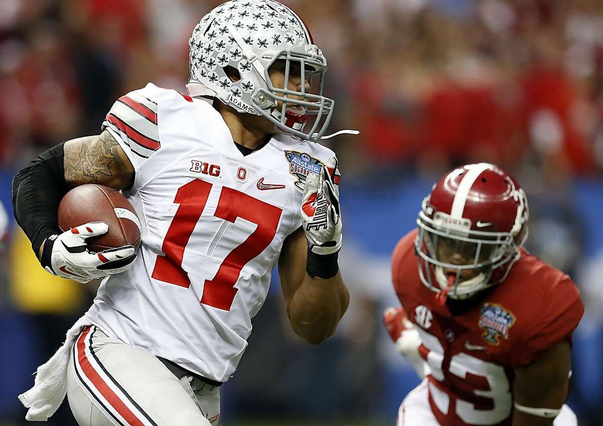 Ohio State running back Jalin Marshall (17) tries to get around Alabama defensive back Jabriel Washington (23) during a kick return in the first half of an NCAA college football game Thursday, Jan. 1, 2015, in New Orleans. (AP Photo/Butch Dill)
